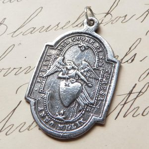 Angel Carrying A Heart Medal